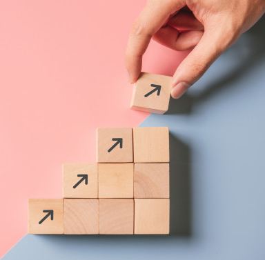 business-concept-growth-success-process-close-up-man-hand-arranging-wood-block-stacking-as-step-stair-paper-blue-pink_52701-81